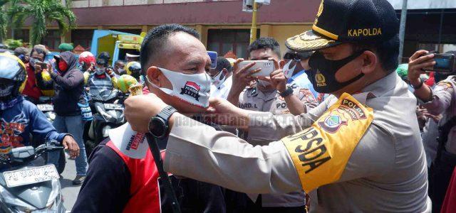 Kampanye Protokol Kesehatan, Polda Papua Barat Bagi 200 Ribu Masker