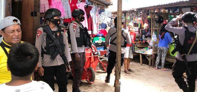 Brimob Polda Papua Barat dan Personil Pos Pam Warior Gelar Patroli Jalan Kaki